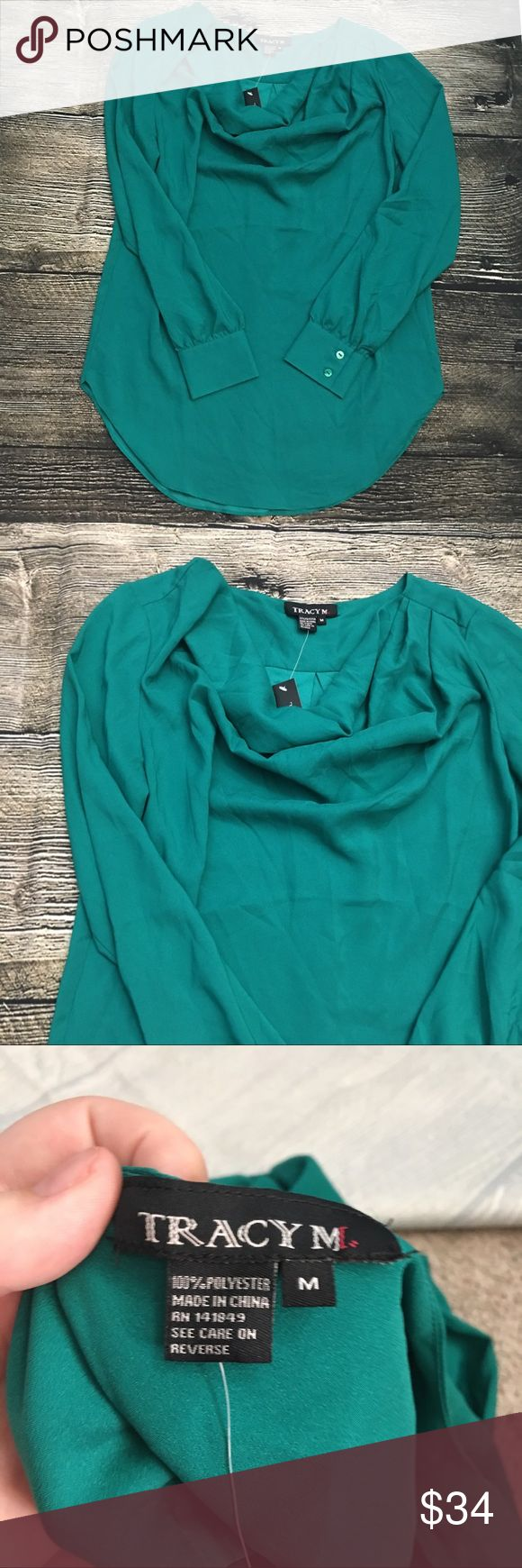"Tracy M Blouse New with tags. Tracy M Blouse with a slouchy neck area and nice sleeves with buttons. Style number 228. The color looks to be a teal color but more green than blue (cyan maybe?). The shirt measures about 20"" from armpit to armpit laying flat and about 29"" long laying flat.  Pet Friendly Home, Smoke Free Home , No trades. Offers, Bundles, and Questions Encouraged Tracy M Tops Blouses"