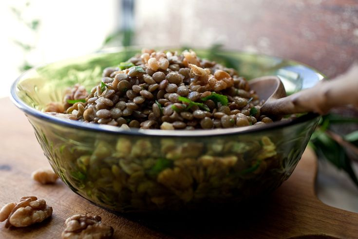 """NYT Cooking: This dish is inspired by a recipe from """"The Paris Cookbook,"""" by Patricia Wells. I'd never thought about using walnut oil, which is high in omega-3 fats, with lentils. It's a great combination. Be sure to keep walnut oil in the refrigerator once it's opened."""
