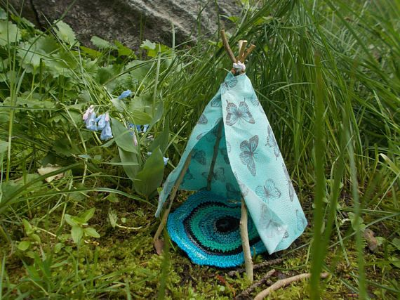 Aqua teepee with butterfly print. Charming and unique addition for home decor or Miniature Garden.  Miniature Fairy Garden Teepee 6 H. Raw cut fabric edges are part of the teepees charm. Fabric is lightly starched to help hold form, and edges have been treated to prevent fraying. The rug is crocheted with coordinating colors and finished with a scalloped edge. Banner has 7 flags, each with a different pattern and has been treated to hold form and avoid fraying.  Teepee is approximately 6…