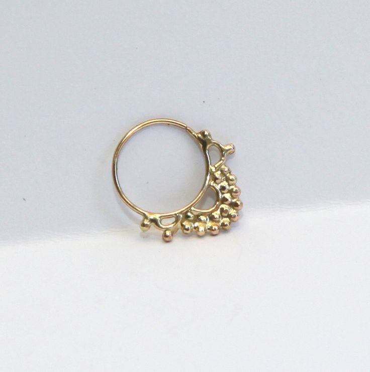 Gold septum jewelry 14k yellow gold - Septum ring - nose ring - tragus - Nose jewelry - tragus - cool christmas gift. $95.00, via Etsy.