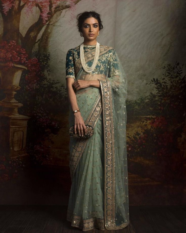 light green net sari paired with foest green blouse  #Trending, #TrendingBridalWear, #BridalWearInspirations, #LehengaInspirations, #TrendingLehengas, #BridalLehengas, #BridalWear, #FloralLehengas, #RedLehengas, #Sabyasachi, #SilkLehengas#bestofsabyasachi #firdauscouturecollection #shaadisaga