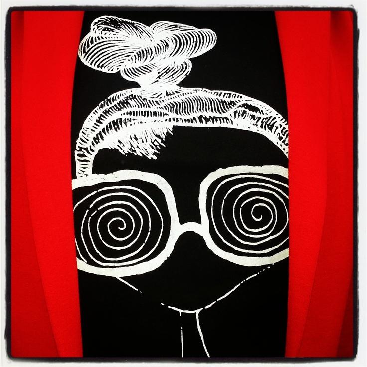 Wearing red blazer on black T-shirt!