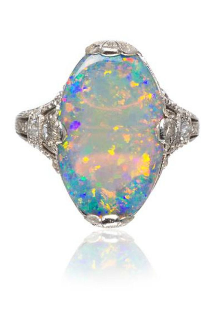 A must-have for anyone who loves vintage and opals! This Edwardian era platinum, diamond, and opal ring is just too beautiful.