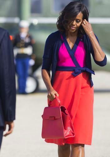 First Lady Michelle Obama in Zac Posen, and sporting a Zac Posen Eartha Satchel