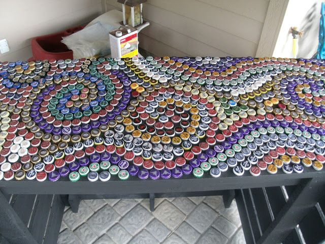 want to finish saving up enough bottle caps to do this on my table!!!