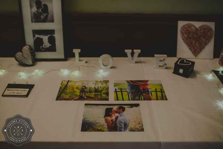 One way of showing off your engagement photos during the wedding reception. http://johannahietanen.com