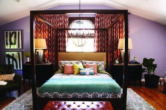 """Thom's solution: """"Hang ikat, or flame-stitched, curtains near the ceiling and extend them horizontally past the window to create a dramatic backdrop for the bed."""""""