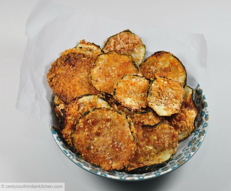 Zucchini Chips: Baked with Parmesan Cheese, bread crumbs and Garam masala and chili powder. Hard to say no to this.