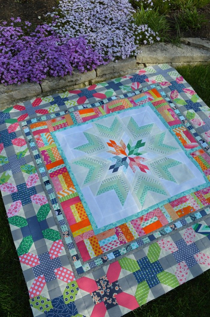 Aviatrix medallion quilt by Sharon McConnell. Bright color patchwork, fun scrappy borders