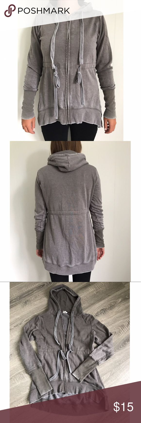 Grey zip up sweatshirt Grey Zip up sweatshirt. From tillys size M. Ties around hood and waist. Lower in the back and small slits at bottom on sides. Tops Sweatshirts & Hoodies