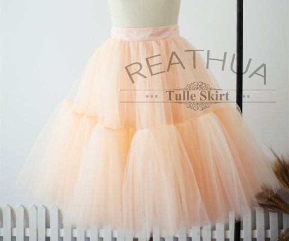 Default feature of the skirt: Peach pink tulle skirt with a seam at the middle where extra layers added for fuller look Knee length cut ( The listed skirt is made in 23 inches long) Flat satin waistband Prefect amount of fullness with soft satin lining The skirt is fully lined so the tulle will not scratch your leg. We size the skirt in 5 sizes as below:  Size XS: Waist of 25 inches/64CM Length of 21 inches/54CM ***********************************************************************...