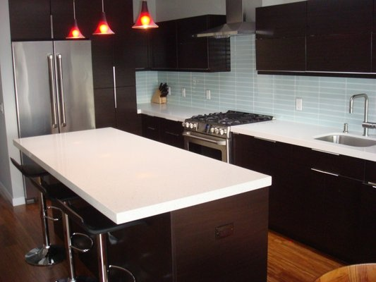 New kitchen with Ultracraft Thermofoil cabinets in wenge with Caesarstone counters.