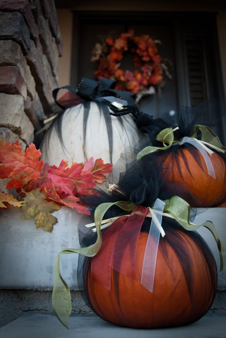 Pumpkins wrapped in tulle and finished off with ribbons.