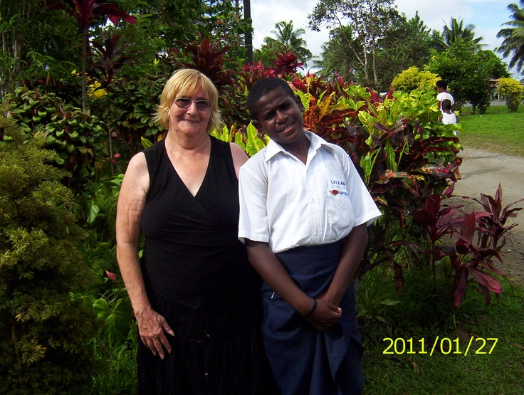 MY ADOPTED SON NAVI AND I IN FRONT OF NEIGHBOURS GARDEN IN NAUSORI