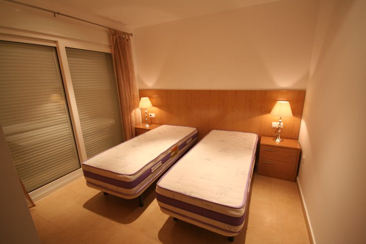 two single beds that can be connected