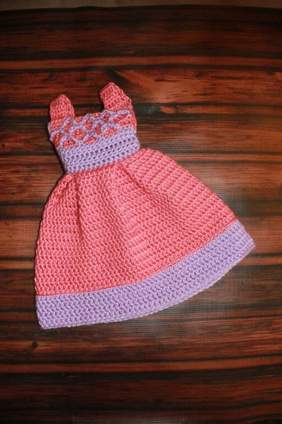 The beautiful crocheted doll dress has a stunning design. This would be adorable to dress up any 18 inch doll. It can be made in a variety of colors. If you hav