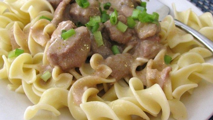 Beef, condensed golden mushroom soup, chopped onion, and Worcestershire sauce simmer in a slow cooker for easy beef stroganoff.