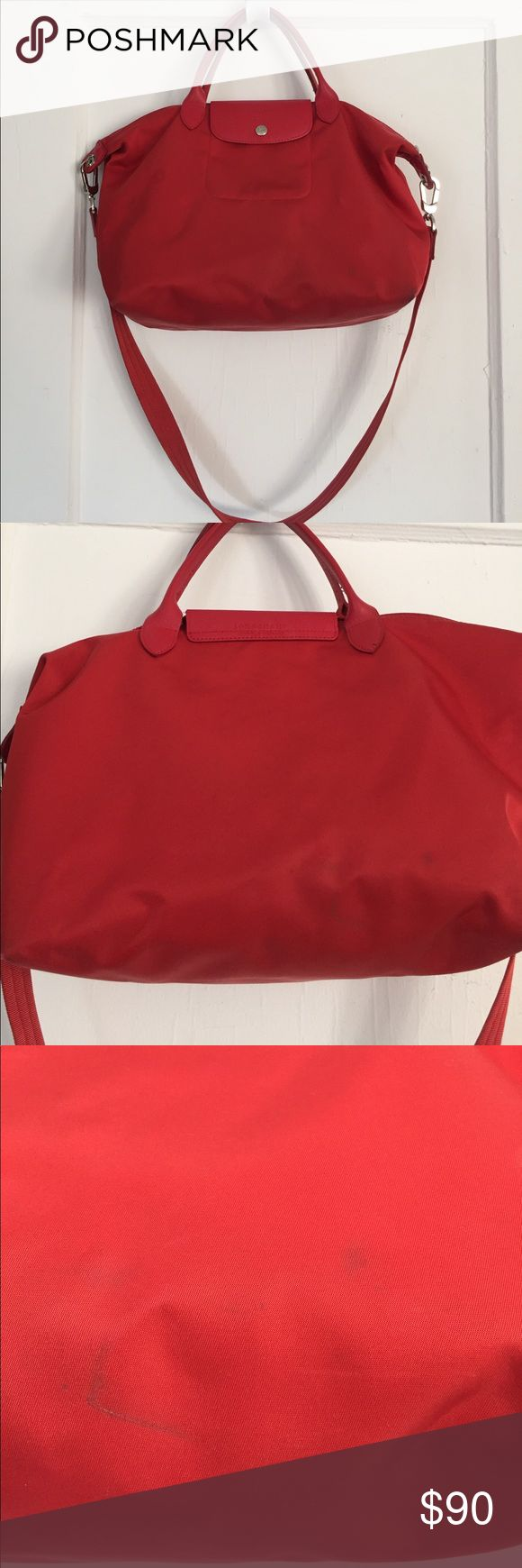 Longchamp Le Pliage Neo Medium Tote bag Longchamp Le Pliage Neo Medium Tote bag in red. Has double leather handles and a detachable shoulder strap. Really spacious interior and lined so spillage is not a problem. Has both a zipper closure and a snap-tab closure. Has some stains and marks as seen in the pictures. Great carryall! Longchamp Bags Totes