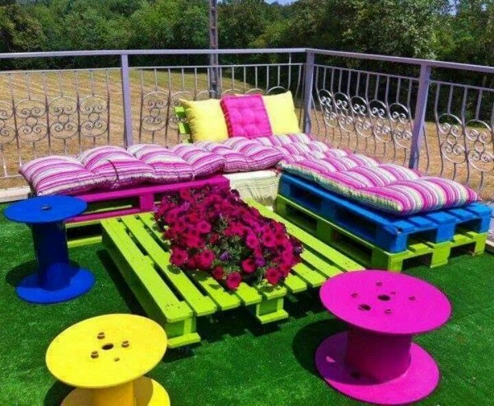 Bright colors in this outdoor furniture made out of spools and pallets.