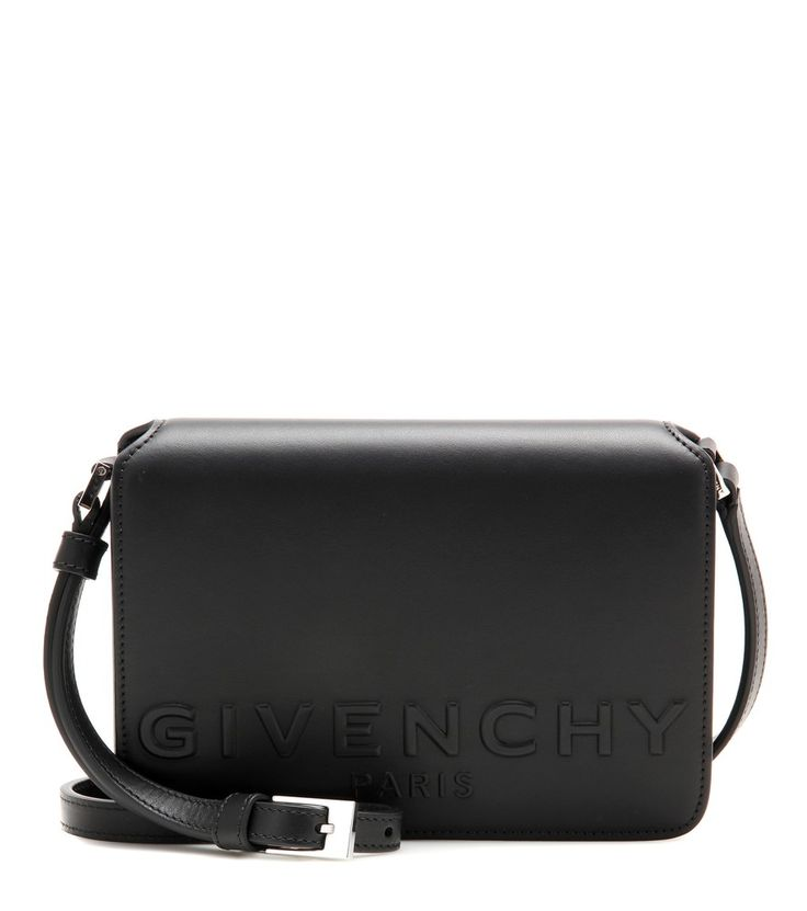 Givenchy - New Small Xbody leather crossbody bag - Givenchy's New Small Xbody has been crafted in Italy from smooth, black leather and features a simplified design for easy, all day accessorising. The designer's name adorning the front ensures this is a recognisable silhouette. seen @ www.mytheresa.com