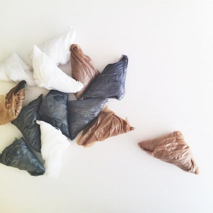 Design Sponge - fold plastic bags into tiny triangles to safe space & avoid tangled bags