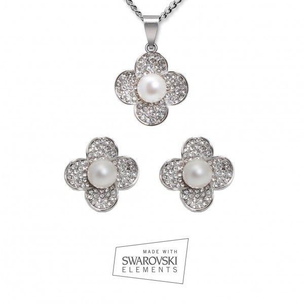 Conjunto Flor Perla Blanca ¡Ideal para agregar un toque de brillo a su look del día! Este #conjunto elegante en forma de flor incluye un #colgante bañado en oro blanco 18 k y #pendientes. http://ow.ly/z7yNK