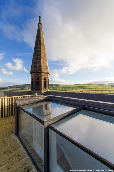 Glass box rooflight solution for terrace access and aesthetics