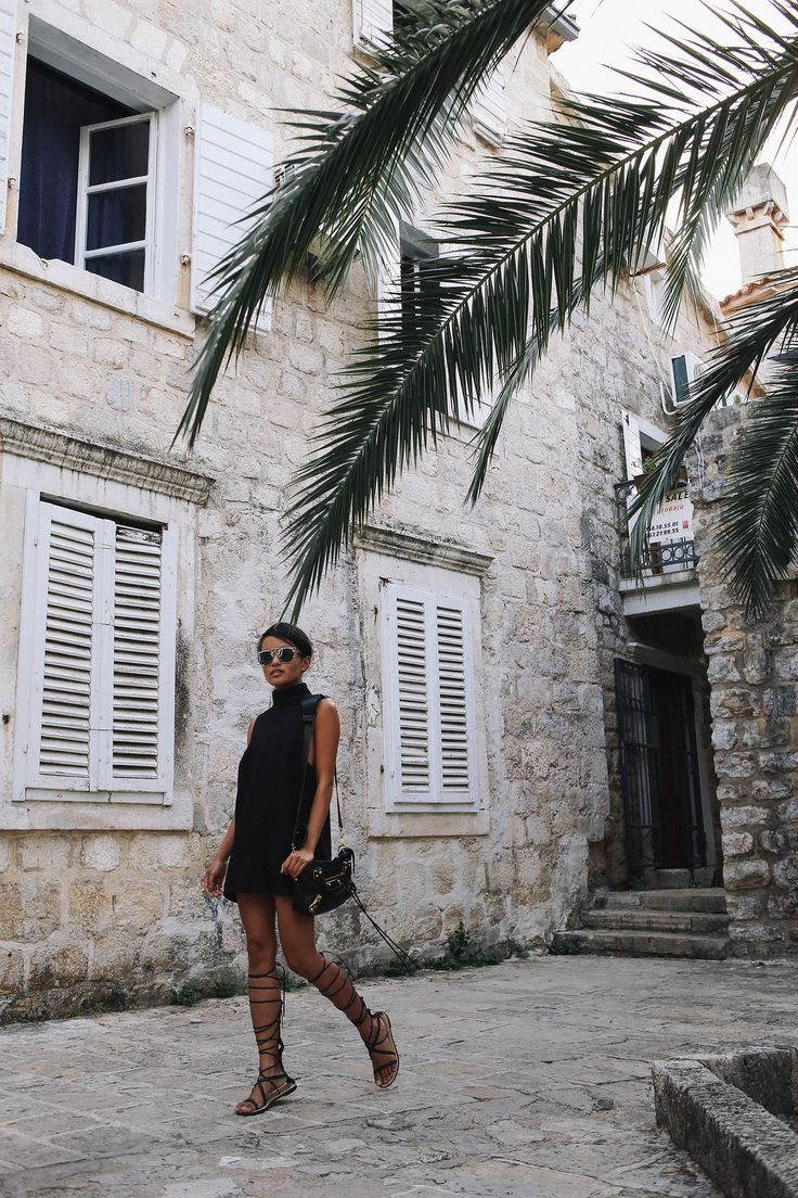Olivia Lopez from the blog Lust for Life wearing a black mini dress and gladiator sandals