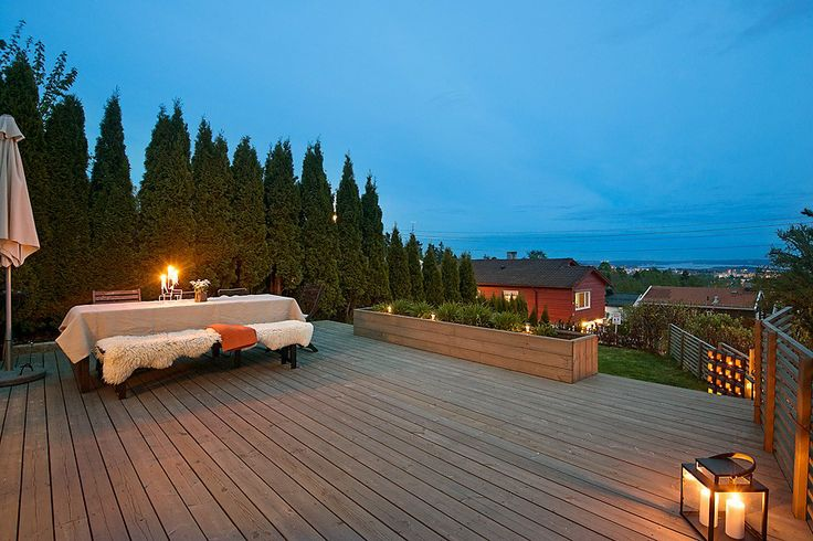 DYI outdoor wood deck with flower wood box and wood fence