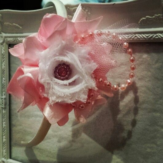 My favorite! Handmade satin petals, with a shabby chiffon flower with pretty pink accent. I added string of pearls with bit of tulle to finish it. Pretty don't you think?