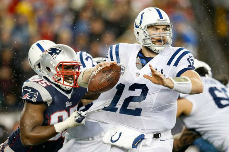 New England Patriots defensive end Chandler Jones (95) grabs the jersey of Indianapolis Colts quarterback Andrew Luck (12) as Luck looks for an opening to pass during the first half. (Michael Dwyer/AP)