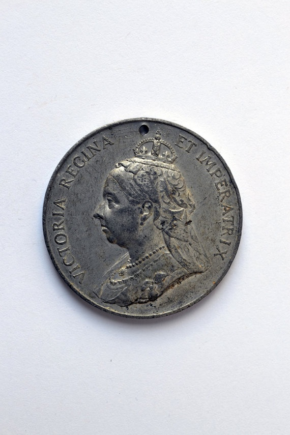 1897 Queen Victoria Jubilee visit to Sheffield medal. $9,60, via Etsy.