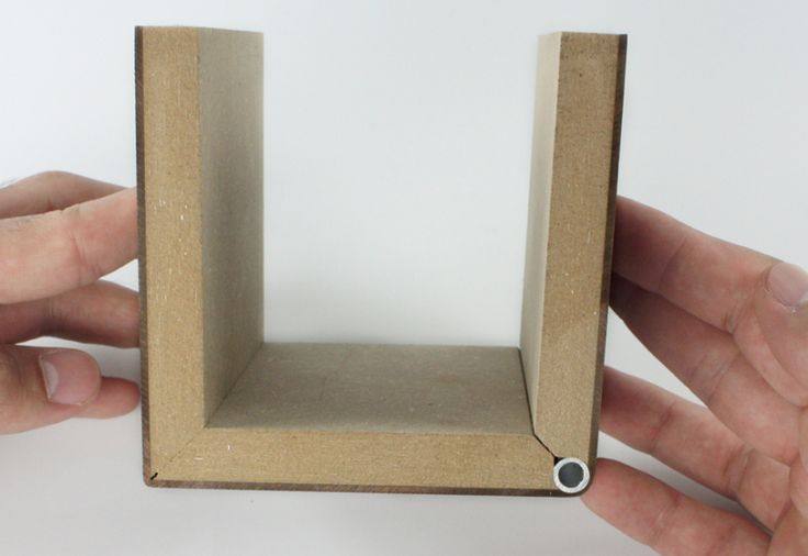 """The """"living hinge"""" you see molded into clamshell packaging has always been the domain of plastic; metal and wood don't like the repetitive stress of bending. But Bavarian fabrication firm Ackermann has worked out a way to do a living hinge in plywood. The trick is to laminate a sheet"""