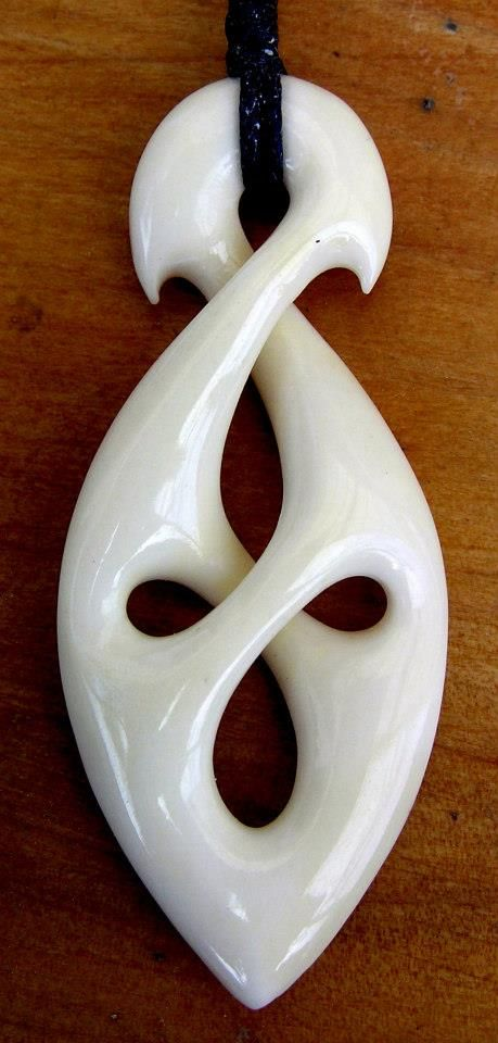 I know this is a Bone Carving.. but I'd love to see it in wood! Beautiful!