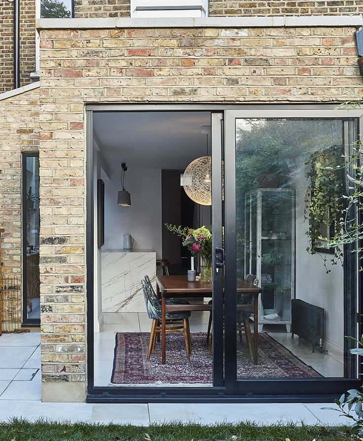 ESSENTIAL KITCHENS & PLUCK LONDON - From the outside looking it. Creative Director Amy Powney's kitchen and garden. #motherofpearl #pearlyqueen #interiors #kitchens #amypowney