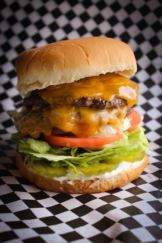 Pilot Burger 1/2lb patty served with lettuce, tomato, pickle, onion,  mayo & mustard. $8.50