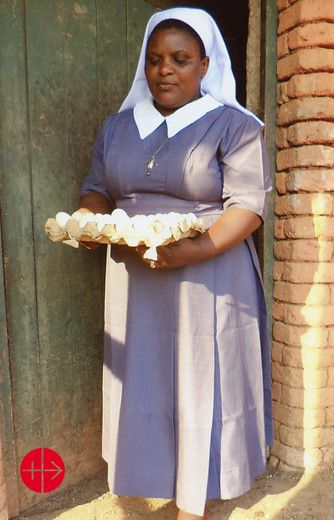 Self sustainable poultry project for the Sisters of Our Lady Queen of the Apostles of Mbeya - Kisa Convent: Sister with eggs from the poultry project