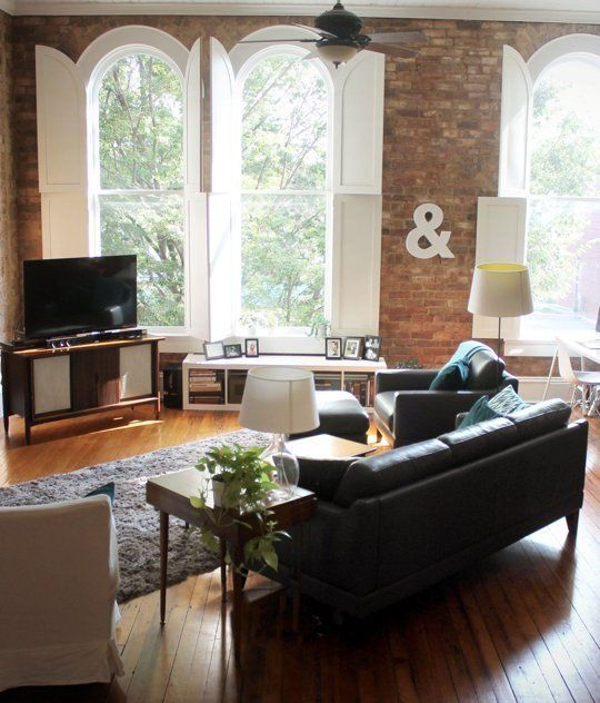 100 Year Old Apartment in North Carolina. Gorgeous hardwood, exposed brick, large windows and simple furnishings.