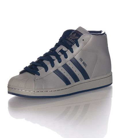 adidas Mid top men's sneaker Triple adidas stripes on sides Padded tongue with adidas logo Leather upper Cusioned inner sole Extra laces included