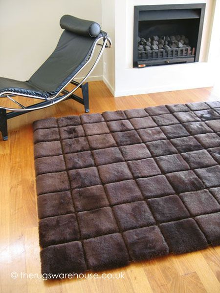 Stella Rug, a chocolate brown 100% New Zealand sheepskin rug with a squares pattern http://www.therugswarehouse.co.uk/sheepskin-rugs/stella-rug.html #rugs #interiors