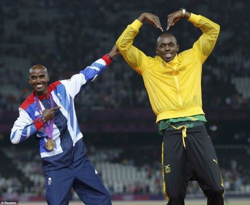 Jamaica's Usain Bolt celebrates with Britain's Mo Farah on the podium. London 2012