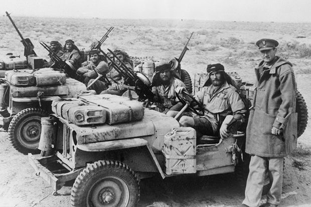 A Special Air Service jeep patrol is greeted by its commander David Stirling on its return from the desert in January 1943