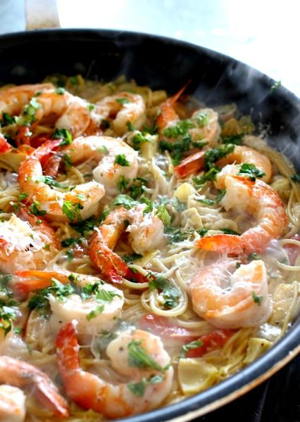 One pan shrimp and artichoke pasta, the pasta cooks right in the broth!