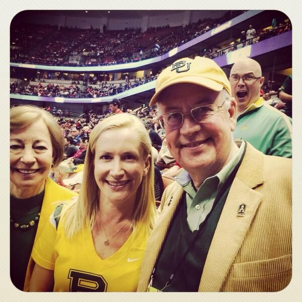 """Actress Angela Kinsey, BA '93 (""""The Office"""") with #Baylor President Ken Starr and First Lady Alice at the NCAA Sweet 16 in Anaheim. (Amazing photobomb courtesy producer/writer Derek Haas, BA '91, MA '95)"""
