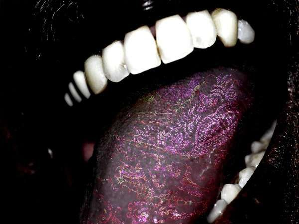 Tongue Tattoo = > Crazy People...but it does look kinda cool : ]~