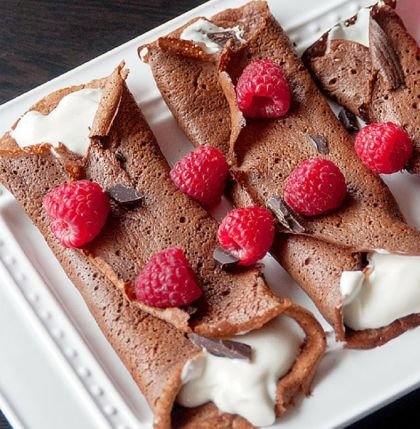Healthy Chocolate Crepes {Gluten and Grain Free} | From Bewitchin Kitchen | #Eggs #GetCracking For those who like their breakfasts extra sweet (but without gluten, grains, or processed sugar) this recipe for chocolate crepes might just be your new go-to. Filled with Greek yogurt and topped with berries, this tasty dish works just as well as a healthy dessert option as it does the first meal of the day.