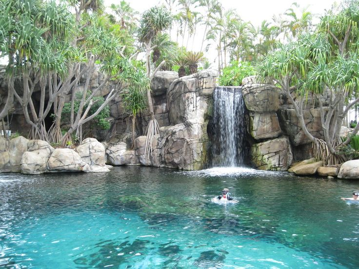 I love this swimming pool! The waterfall looks natural.