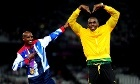 Great Britain Mo Farah (left) celebrates his victory in the Men's 5000 metres with Jamaica's Usain Bolt