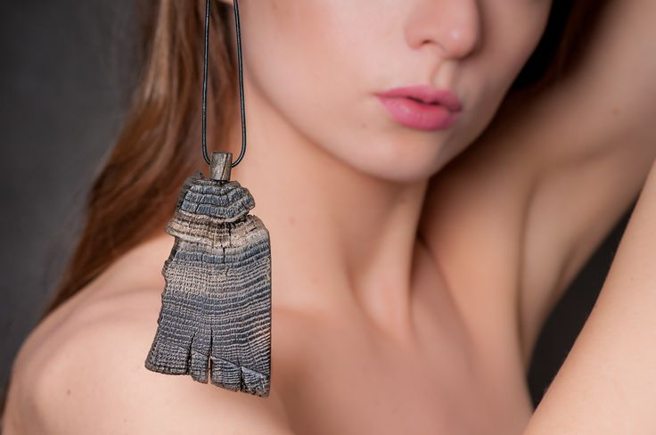 Historical black oak dating back to the 14th century combined with amber. Pendant model no 22.
