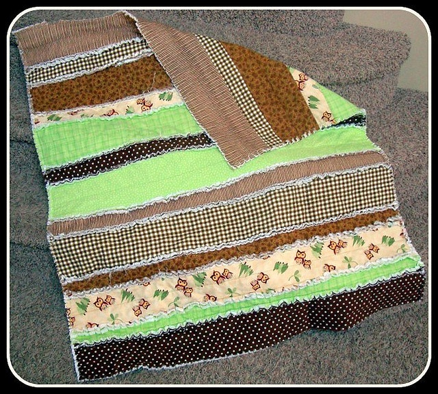 Strip rag quilt - a lot less cutting involved.  Should probably try this style first.